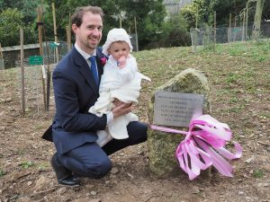 Isla Rose at the plaque