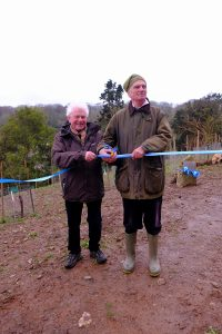 Sir Richard Carew Pole V.M.H and Roy Lancaster V.M.H cut the ribbon
