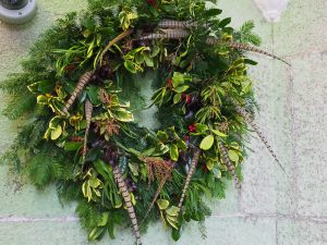 pheasant tail and holly wreath