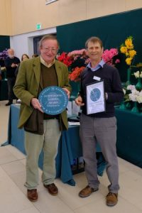 CHW receives the RCMG outstanding magnolia plaques from David Millais